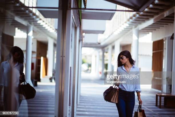 beautiful brunette woman with coffee shopping in the city - avenue stock pictures, royalty-free photos & images