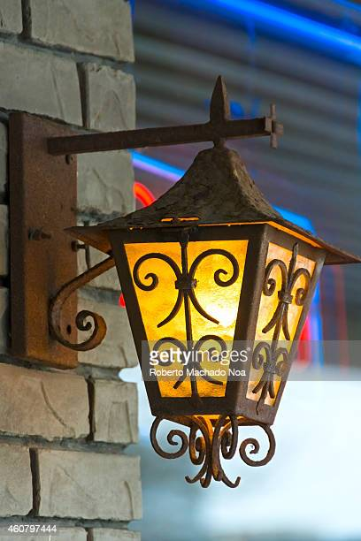 Beautiful business outdoor lamp lit during the day in a city establishment