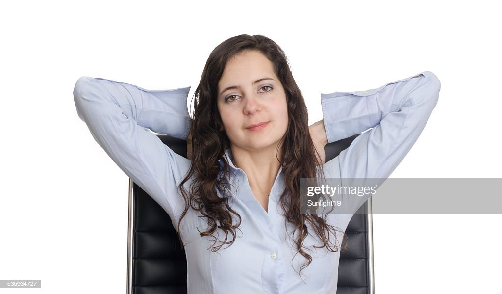 Beautiful business woman sitting on a chair. : Stock Photo