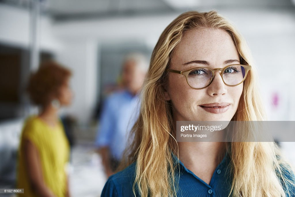 Beautiful businesswoman at creative office : Stock Photo