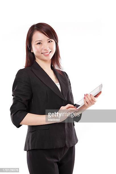 美しいビジネスウーマンのタブレットを手に、笑顔に白背景