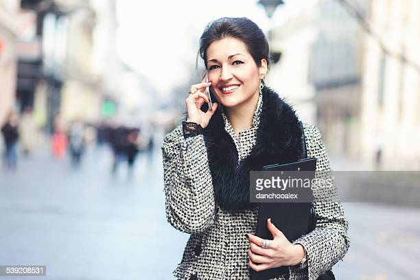 Beautiful businesswoman in the city