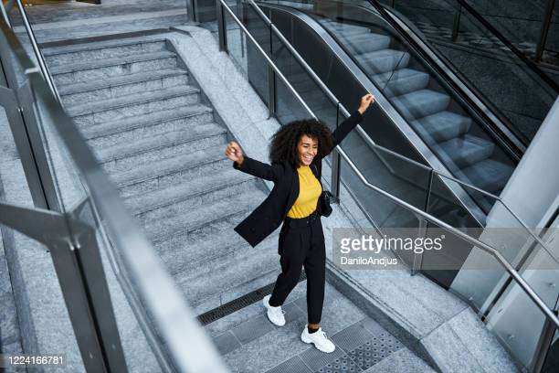 beautiful businesswoman outdoors - employee stock pictures, royalty-free photos & images