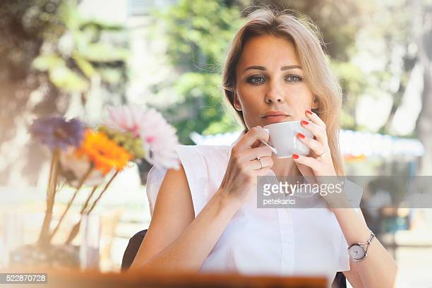 beautiful businesswoman resting in cafe - human mouth stock pictures, royalty-free photos & images