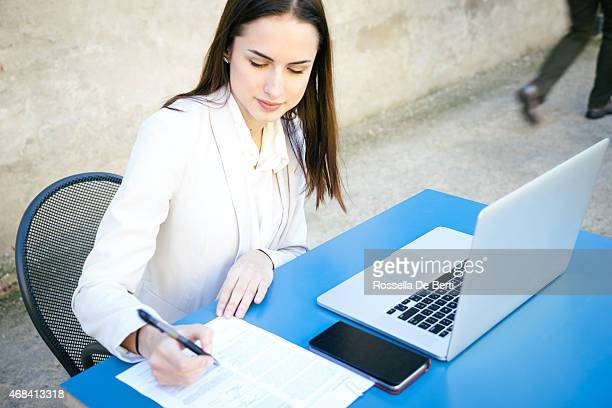 Beautiful Businesswoman Signing Contract
