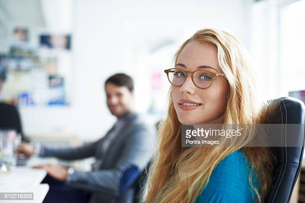 Beautiful businesswoman sitting in creative office