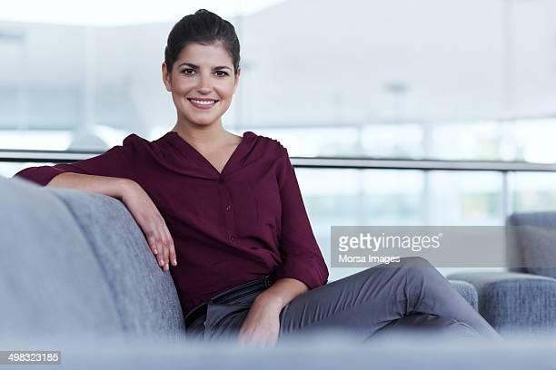 Beautiful businesswoman sitting on sofa