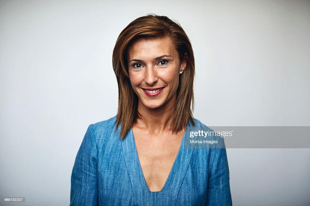 Beautiful businesswoman smiling over white : Stock Photo