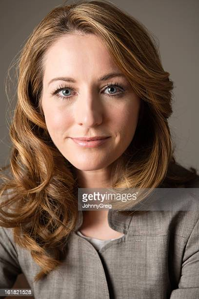 beautiful businesswoman smiling - grey eyes stock pictures, royalty-free photos & images
