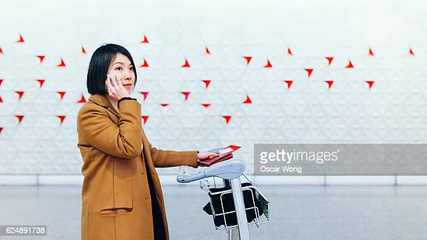 Beautiful businesswoman talking on mobile phone in airport