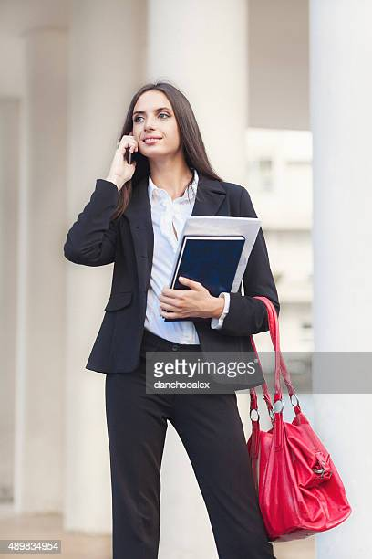Beautiful businesswoman talking on the smart phone
