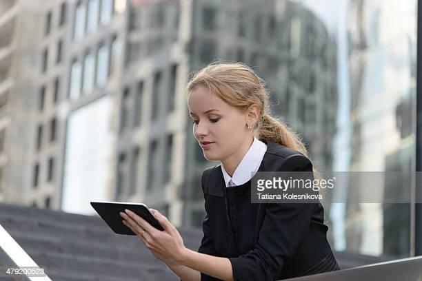 Beautiful businesswoman using tablet