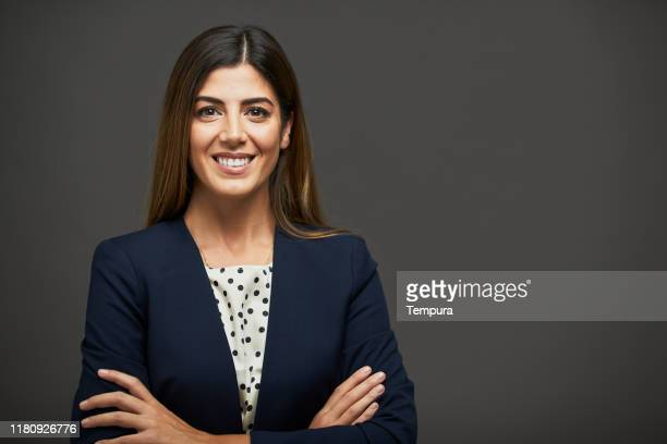 beautiful businesswoman with arms crossed and looking at camera. - waist up stock pictures, royalty-free photos & images