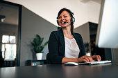 Beautiful call center consultant in headphones.
