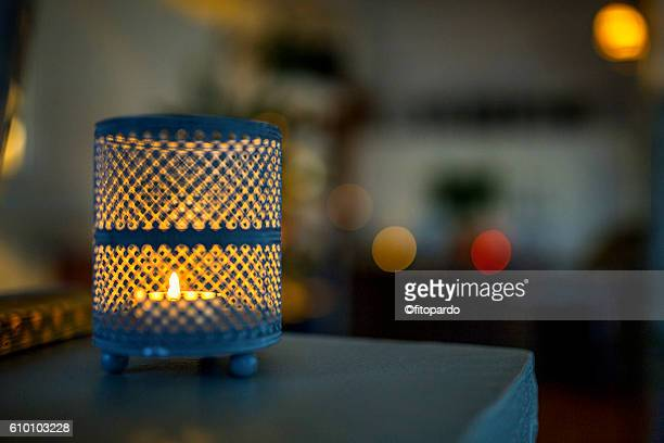 Beautiful Candle in a vase with bokeh