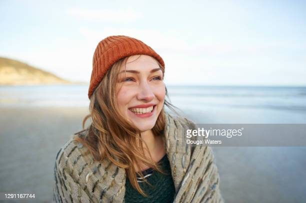 beautiful carefree woman smiling on autumn beach. - low tide stock pictures, royalty-free photos & images