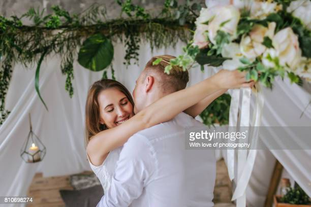 Beautiful caucasian couple in love, wedding couple, romantic hugs and kisses