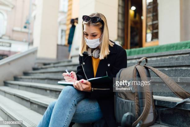 beautiful caucasian female student wearing a face mask - organised group stock pictures, royalty-free photos & images