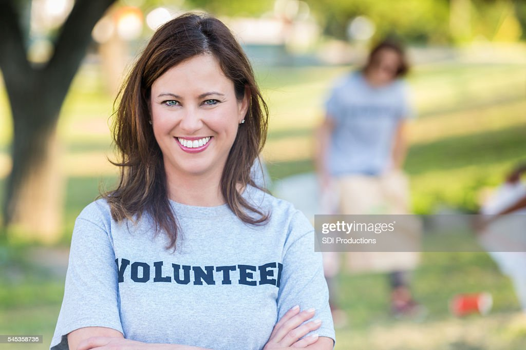 Beautiful Caucasian Woman Volunteering At A Park Clean Up Project