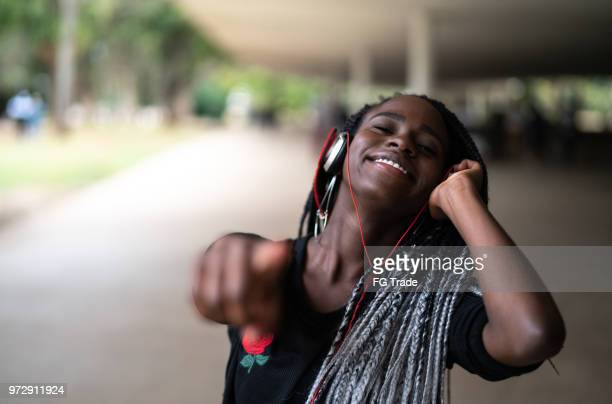 beautiful cheerful girl listening music in the street - ibirapuera park stock pictures, royalty-free photos & images