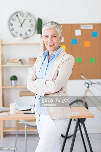 Beautiful cheerful mature woman at office