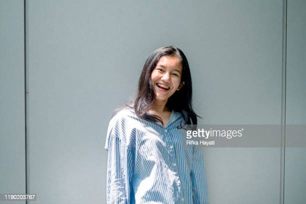beautiful cheerful young asian women - rifka hayati stock pictures, royalty-free photos & images