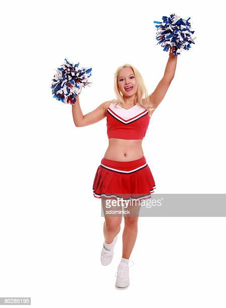 A beautiful cheerleader, isolated on white.