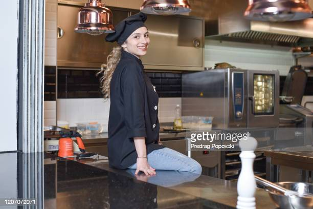 beautiful chef in a kitchen at a restaurant - kumanovo stock pictures, royalty-free photos & images