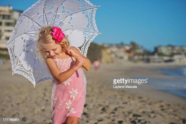 Beautiful Child With Beach Parasol