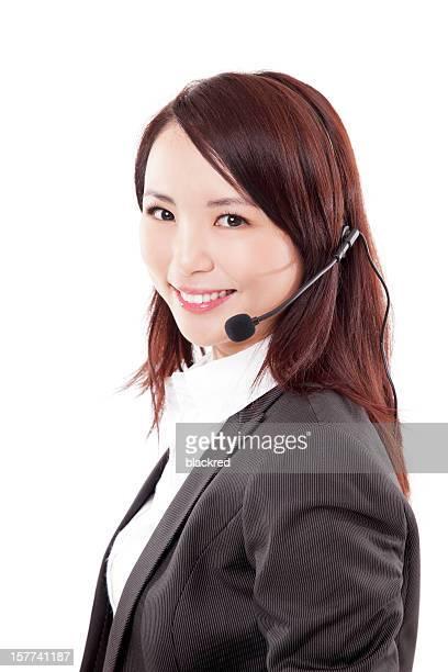 美しい中国のビジネスの顧客サービス白背景で微笑む女性
