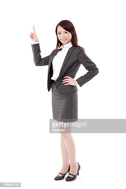 Beautiful Chinese Businesswoman Pointing Smiling on White Background