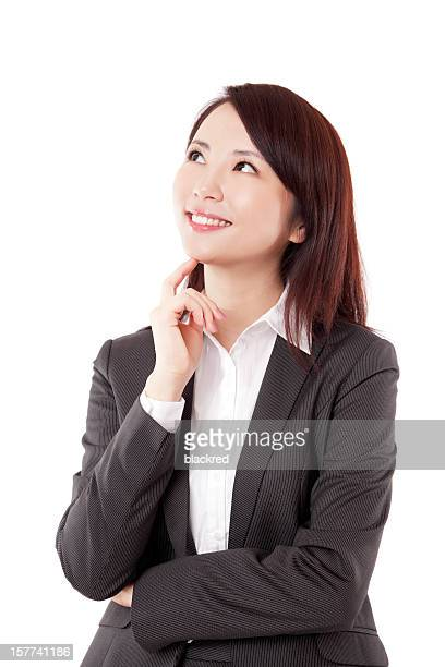 Beautiful Chinese Businesswoman Thinking Smiling Finger on Chin White Background