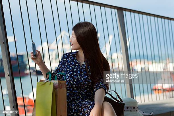 beautiful chinese woman photographing koper, slovenia, europe - koper stock photos and pictures