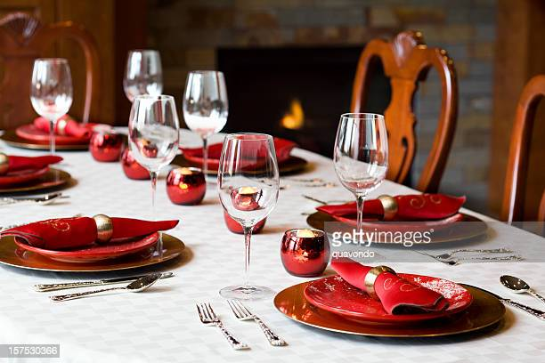 Beautiful Christmas Holiday Table Setting with Fireplace, Copy Space