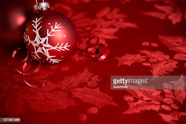 Beautiful Christmas Ornament on Red Holly Background, Copy Space