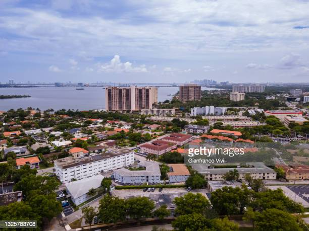 beautiful cinematic aerial view of the miami luxurious suburbs with boats near the ocean - florida us state stock pictures, royalty-free photos & images