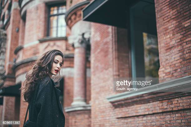 beautiful city girl - long purse stock photos and pictures