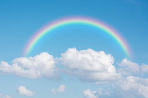 beautiful classic rainbow across in the blue sky after the rain 645594520