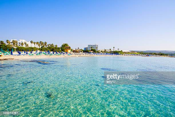 beautiful clear blue sea at macronissos beach in cyprus - cyprus stockfoto's en -beelden
