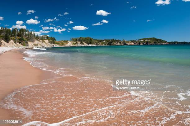 beautiful, clear waters along the cabot trail, ingonish, nova scotia, canada - atlantic ocean stock pictures, royalty-free photos & images