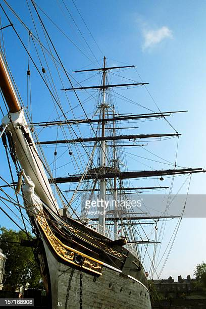 Beautiful clipper ship with sails rolled up