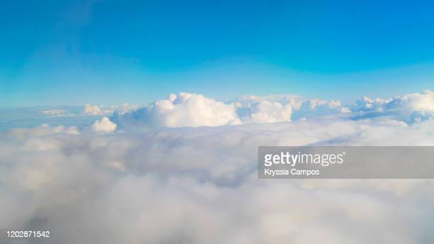 beautiful clouds background - 飛行機の視点 ストックフォトと画像