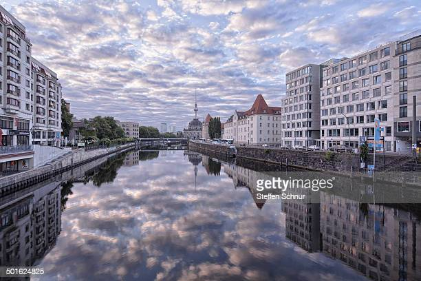 beautiful clouds reflected in the river Berlin