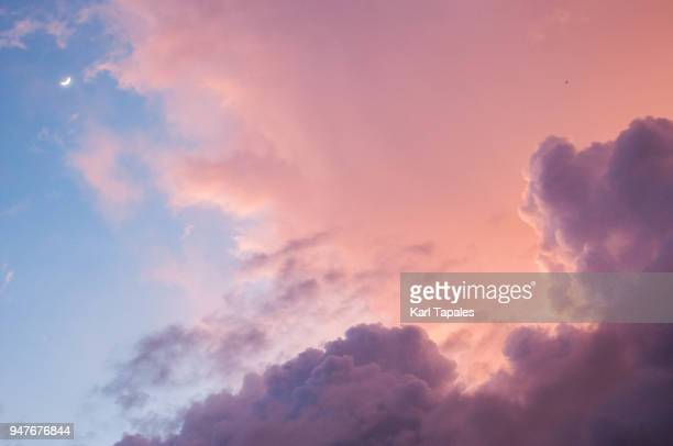 a beautiful cloudscape of red and blue sky - cloud sky stock pictures, royalty-free photos & images