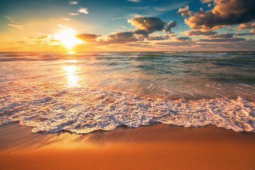Beautiful cloudscape over the sea waves, sunrise shot 1090614334