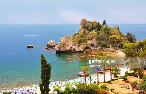 Beautiful coast with Isola Bella in Sicily, Italy.