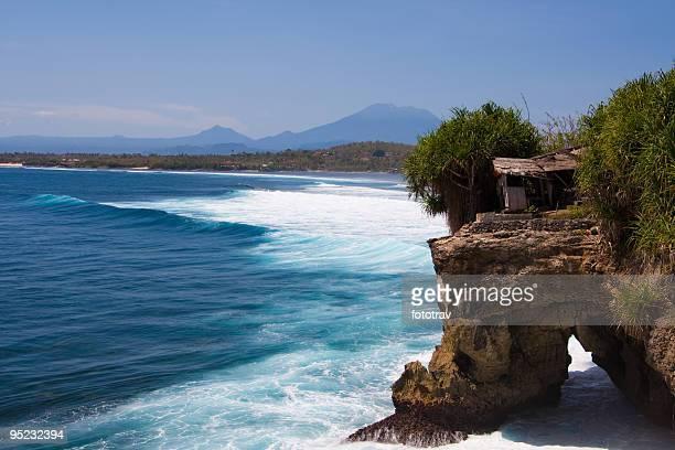 Beautiful coastline waves against rocky shore