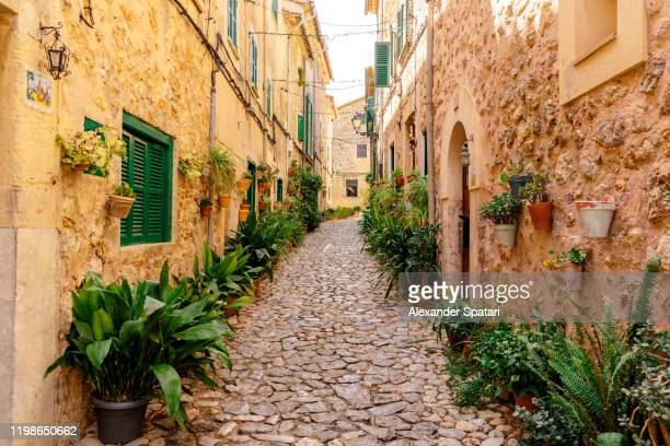 beautiful cobbled street in valdemossa village, mallorca, spain - palma majorca stock pictures, royalty-free photos & images