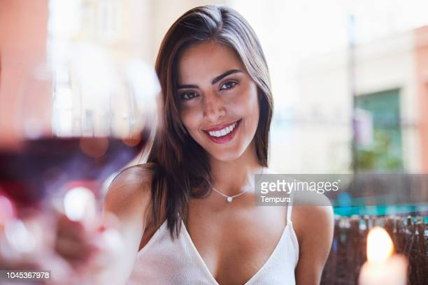 Beautiful Colombian woman wine toasting pov.