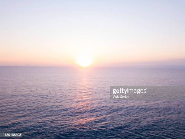 beautiful colored sunrise over the ocean - horizon over water stock pictures, royalty-free photos & images